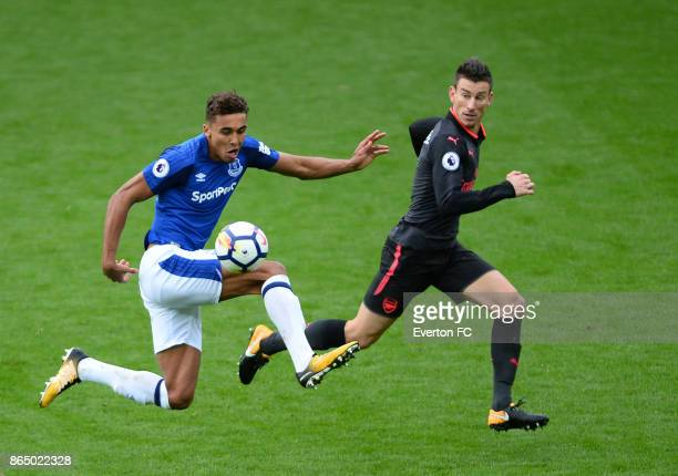 Dominic CalvertLewin of Everton and Laurent Koscielny of Arsenal in action during the Premier League match between Everton and Arsenal at Goodison...