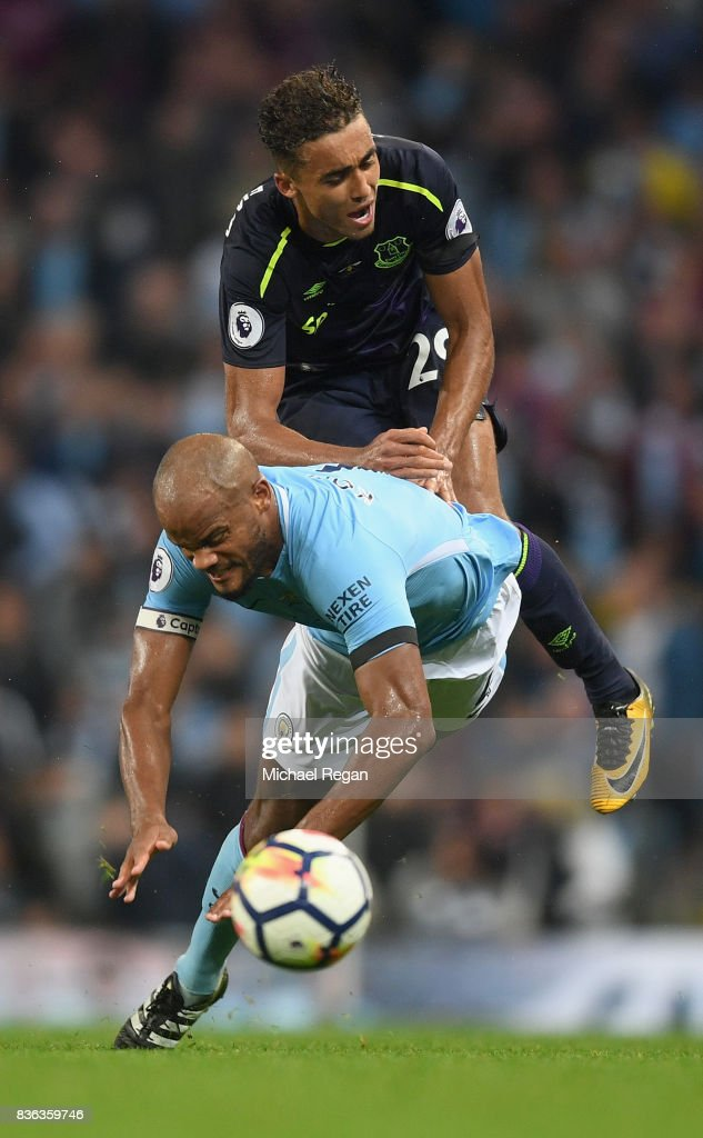 Dominic Calvert-Lewin of Everton and Vincent Kompany of Manchester City battle for possession during the Premier League match between Manchester City and Everton at Etihad Stadium on August 21, 2017 in Manchester, England.