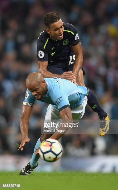 Dominic CalvertLewin of Everton and Vincent Kompany of Manchester City battle for possession during the Premier League match between Manchester City...