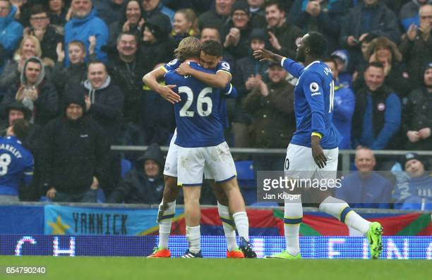 Dominic CalvertLewin of Everton celebrates as he scores their first goal with Tom Davies and Romelu Lukaku during the Premier League match between...