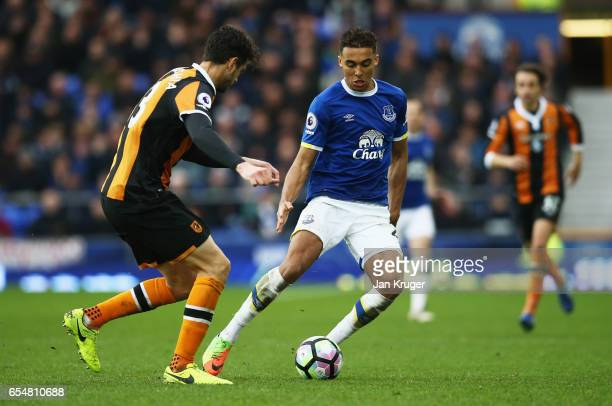 Dominic CalvertLewin of Everton is faced by Andrea Ranocchia of Hull City during the Premier League match between Everton and Hull City at Goodison...