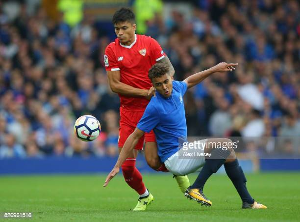 Dominic CalvertLewin of Everton is tackled by Joaquin Correa of Sevilla during a preseason friendly match between Everton and Sevilla at Goodison...