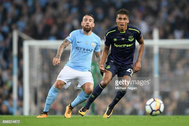 Dominic CalvertLewin of Everton Nicolas Otamendi of Manchester City in action during the Premier League match between Manchester City and Everton at...