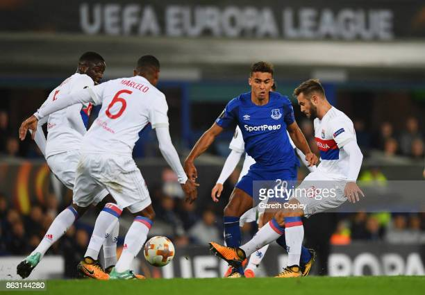Dominic CalvertLewin of Everton takes on Mouctar Diakhaby Marcelo and Lucas Tousart of Lyon during the UEFA Europa League Group E match between...