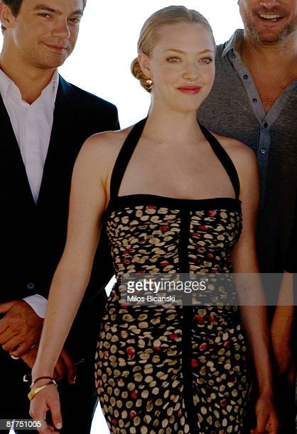 Dominic Cooper and Amanda Seyfried attend a photocall for the movie 'Mamma Mia' at the Lagonissi Grand Resort on June 28 2008 in Athens Greece