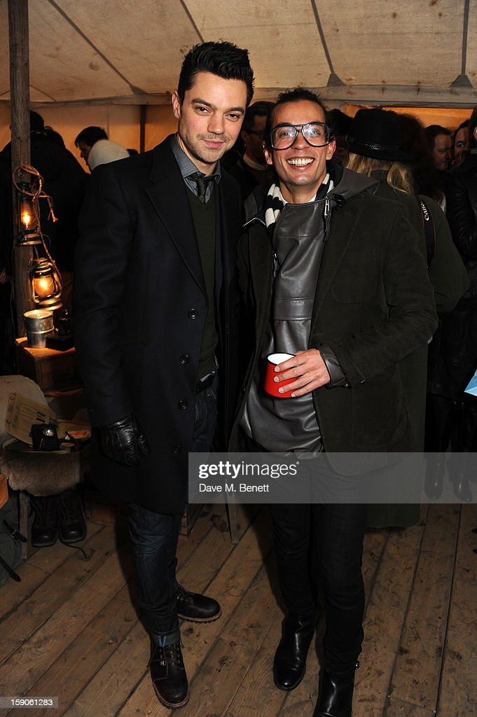Dominic Cooper and Bally designer Michael Herz attend the 'BALLY Celebrates 60 Years of Conquering Everest' at Bedford Square Gardens on January 7, 2013 in London, England.