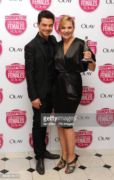 Dominic Cooper and Kim Cattrall with her Ultimate Icon Award at the Cosmopolitan Ultimate Women of the Year Awards at Banqueting House Whitehall...