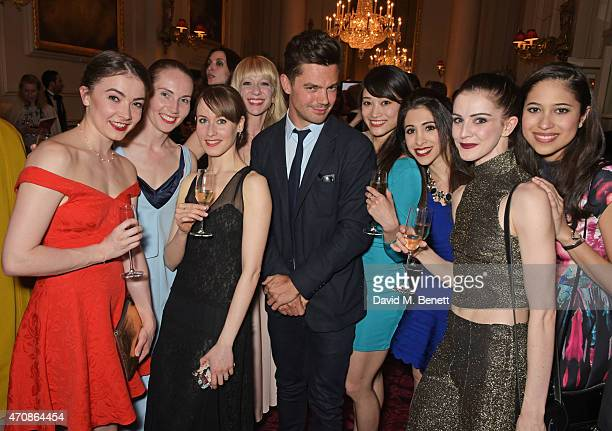 Dominic Cooper poses with ballerinas as Audi hosts the opening night performance of 'La Fille Mal Gardee' at The Royal Opera House on April 23 2015...