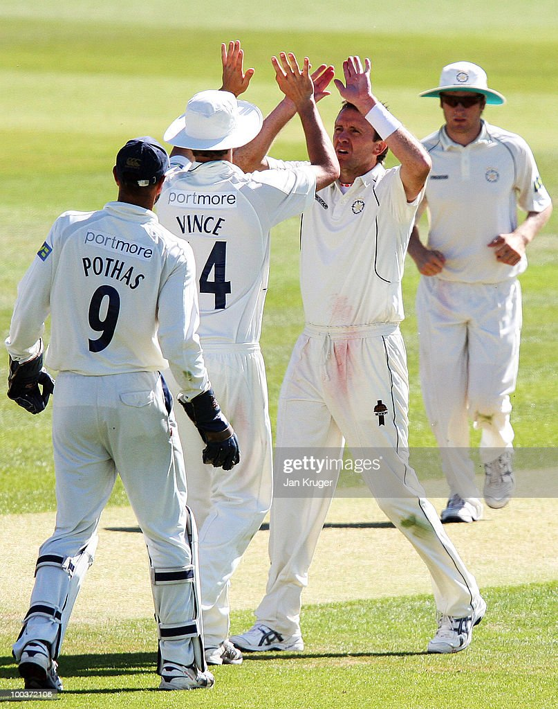 Dominic Cork celebrate the wicket of Joe Sayers of Yorkshire with James Vince of Hampshire during the LV= County Championship Division One match between Hampshire and Yorkshire at The Rose Bowl on May 24, 2010 in Southampton, England.
