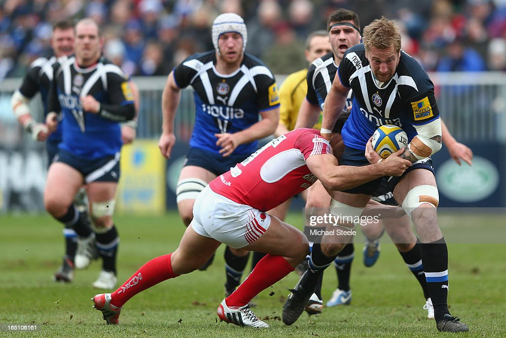 Dominic Day (R) of Bath runs at ArthurJoly (L) of London Welsh during the Aviva Premiership match between Bath and London Welsh at the Recreation Ground on March 30, 2013 in Bath, England.