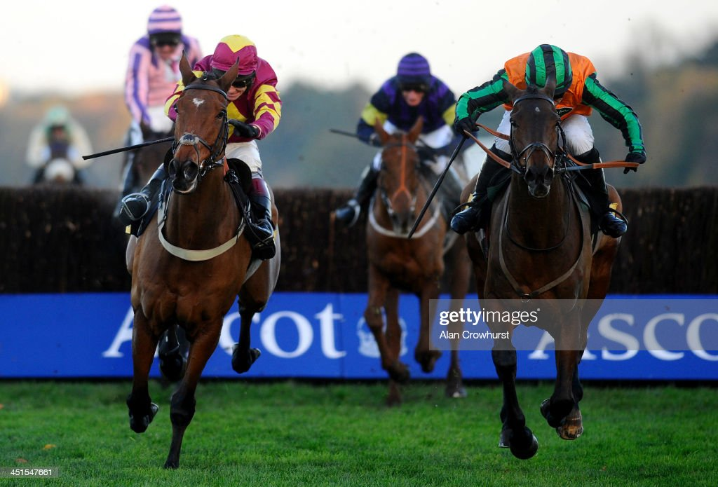 Dominic Elsworth riding Alasi (R) clear the last to win The Carey Group Handicap Steeple Chase at Ascot racecourse on November 23, 2013 in Ascot, England.