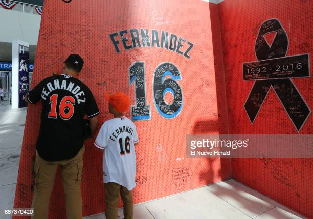 Dominic Estevez left and his brother Armani Estevez look at the Jose Fernandez tribute before the start Miami Marlins' home opener against the...