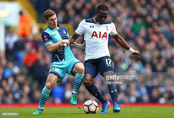 Dominic Gape of Wycombe Wanderers and Moussa Sissoko of Tottenham Hotspur compete for the ball during the Emirates FA Cup Fourth Round match between...