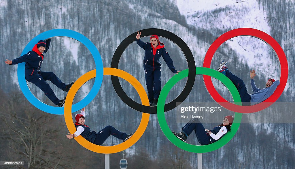 Dominic Harrington, Ben Kilner and Billy Morgan of the Great Britain Snowboard Team pose for a portrait with Rebekah Wilson and Paula Walker of the Great Britain Bobsleigh team on the Olympic rings at the Athletes Village in the Rosa Khutor mountain village cluster prior to the Sochi 2014 Winter Olympics on February 3, 2014 in Sochi, Russia.