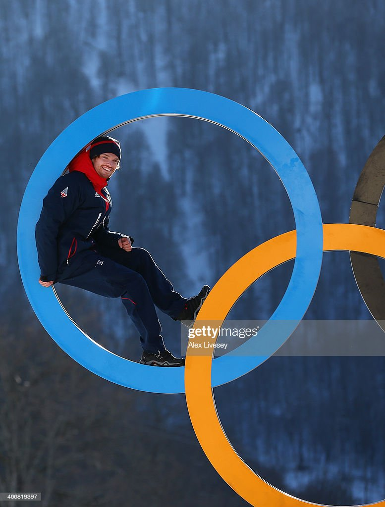 Dominic Harrington of the Great Britain Snowboard Team poses for a portrait on the Olympic rings at the Athletes Village in the Rosa Khutor mountain village cluster prior to the Sochi 2014 Winter Olympics on February 3, 2014 in Sochi, Russia.