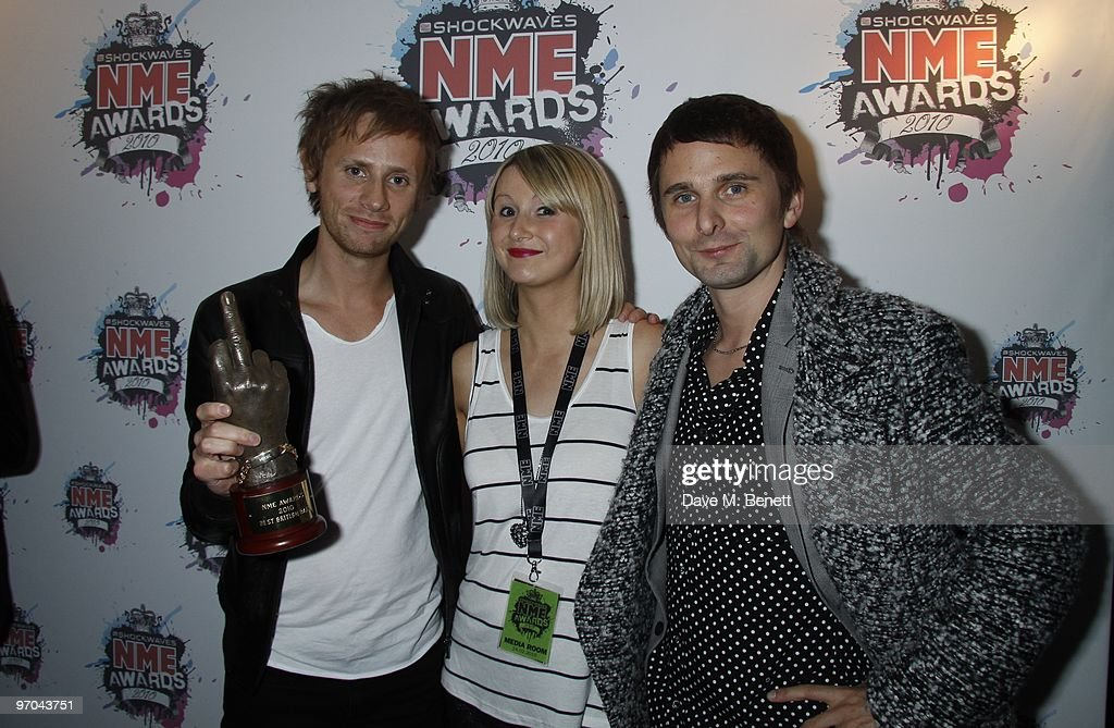 Dominic Howard and Matt Bellamy of Muse pose with their best British band award in front of the winners boards at the Shockwaves NME Awards 2010 held at Brixton Academy on February 24, 2010 in London, England.