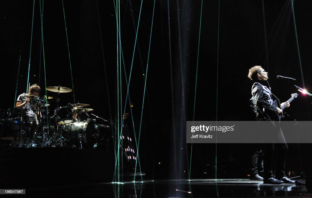 Dominic Howard and Matthew Bellamy of Muse perform onstage during the MTV EMA's 2012 at Festhalle Frankfurt on November 11 2012 in Frankfurt am Main...