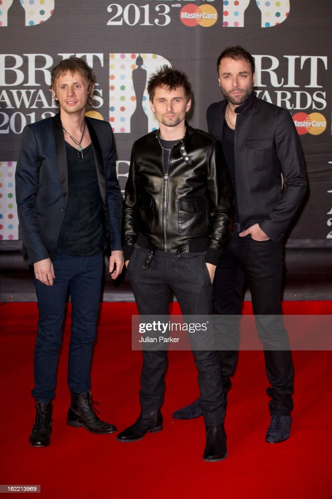 Dominic Howard, Matt Bellamy and Chris Wolstenholme of Muse attend the Brit Awards 2013 at the 02 Arena on February 20, 2013 in London, England.