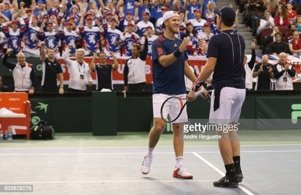Dominic Inglot and Jamie Murray of Great Britain celebrate their win over Vasek Pospisil and Daniel Nestor of Canada after the doubles match on day...