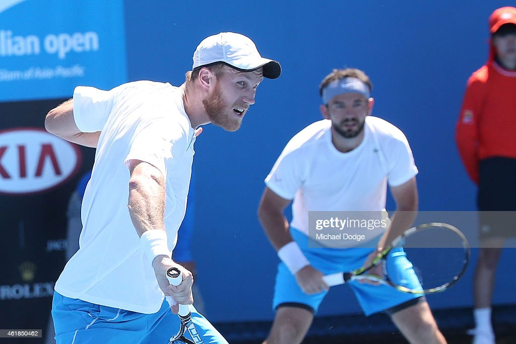 Dominic Inglot of Great Britain and Florin Mergea of Romania in action in their first round doubles match against Matthew Ebden of Australia and Matt...