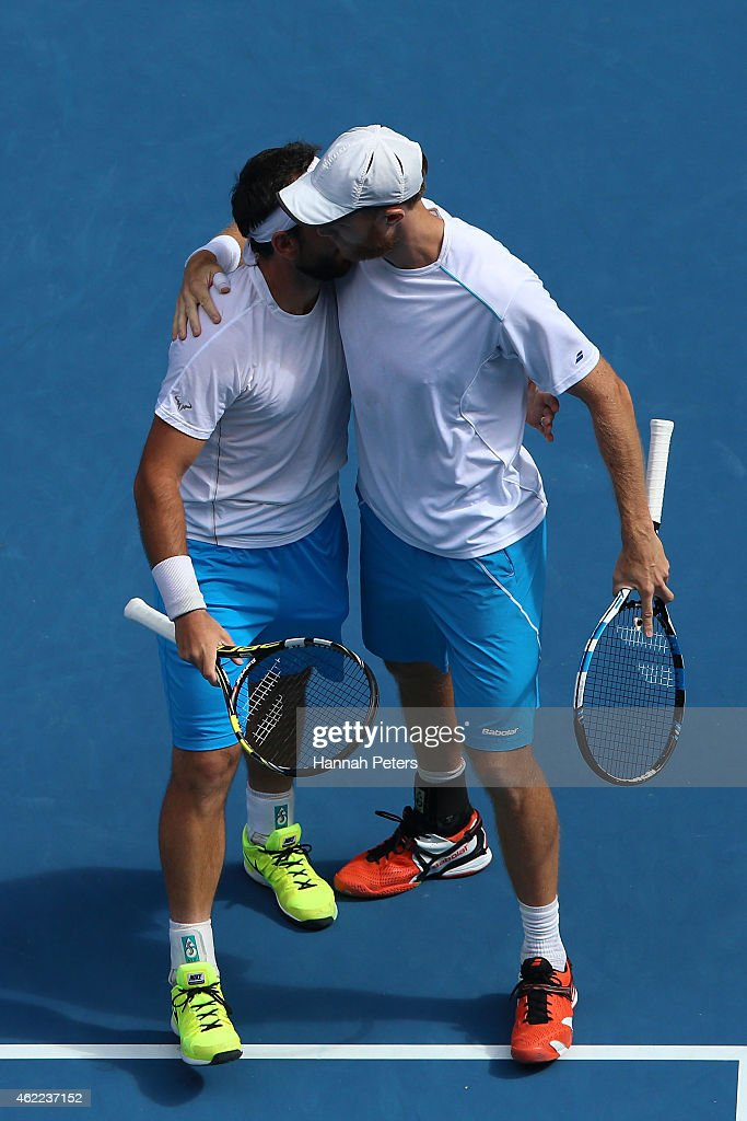 Dominic Inglot of Great Britain and Florin Mergea of Romania in action in their third round doubles match against Bob Bryan of the United States and...