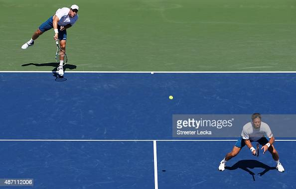 Dominic Inglot of Great Britain and Robert Lindstedt of Sweden play against Tommy Haas of Germany and Radek Stepanek of the Czech Republic during...