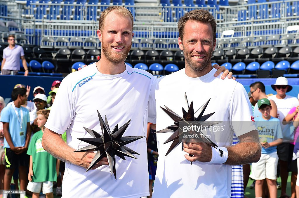 Dominic Inglot of Great Britain and Robert Lindstedt of Sweden pose with their trophies after defeating Eric Butorac and Scott Lipsky after the men's...