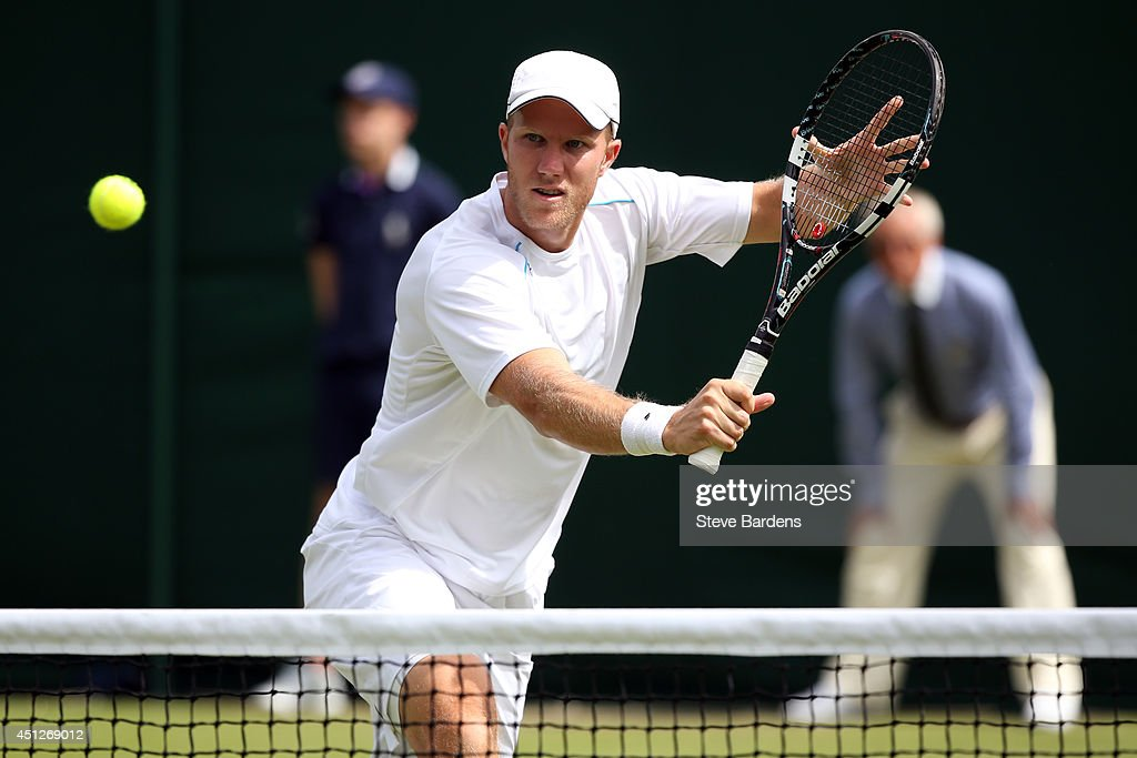 Dominic Inglot of Great Britain during his Gentlemen's Doubles first round match with Treat Huey of Philippines against Mate Pavic of Croatia and...