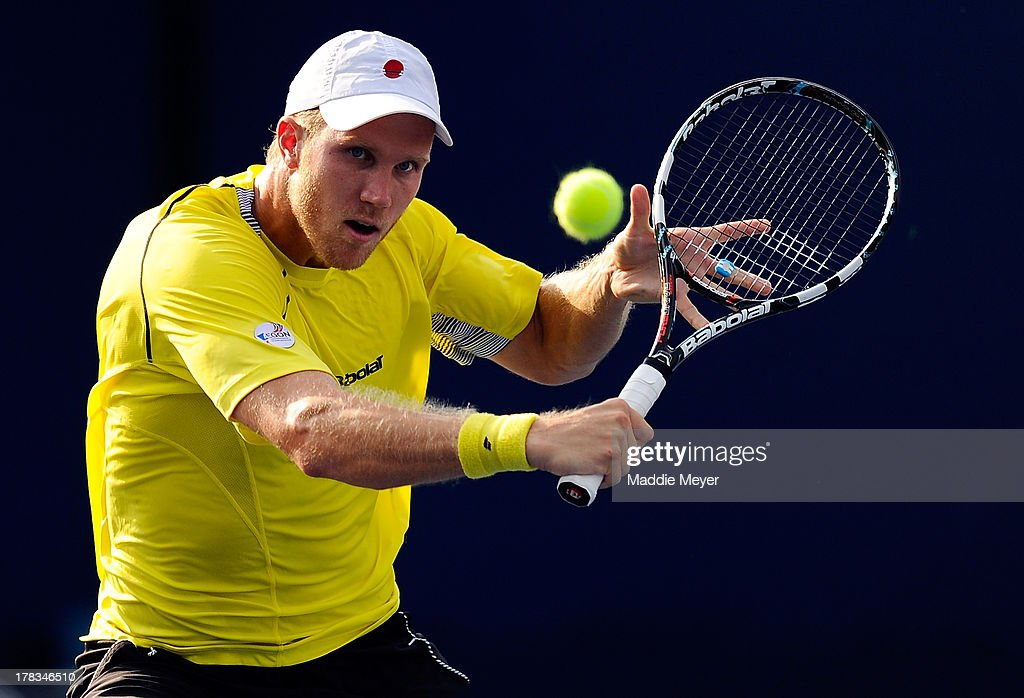 Dominic Inglot of Great Britain in action next to his partner Treat Huey of Philippines during their men's doubles first round match against Julian...
