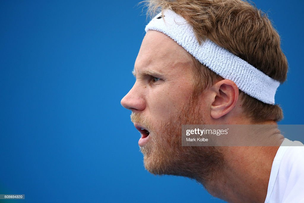 Dominic Inglot of Great Britain prepares to receive a serve in his first round doubles match against Sergey Betov of Belarus and Teymuraz of Russia...