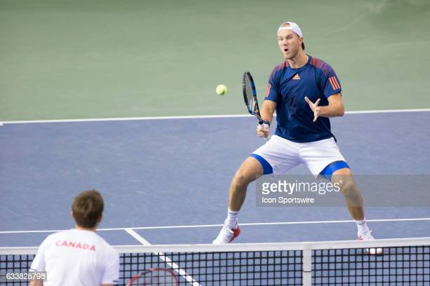 Dominic Inglot of Great Britain reacts to his volley against Vasek Pospisil and Daniel Nestor of Canada in men's doubles play on February 04 2017...