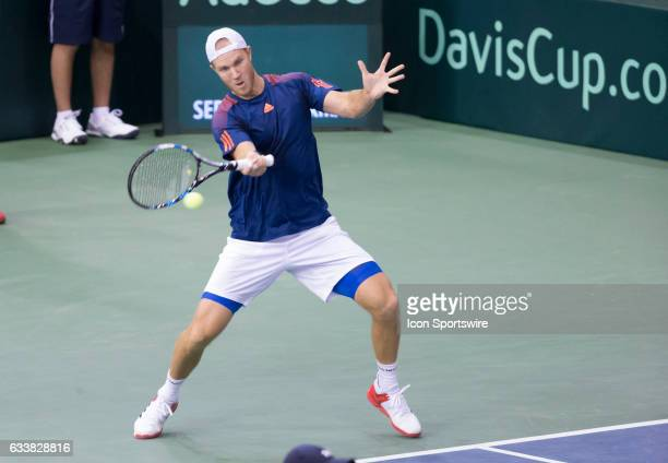Dominic Inglot of Great Britain returns a shot against Vasek Pospisil and Daniel Nestor of Canada in men's doubles play on February 04 2017 during...