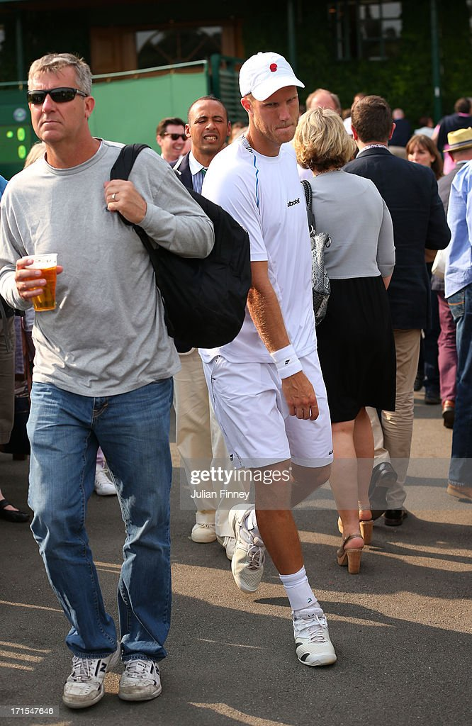 Dominic Inglot of Great Britain walks through the crowd on his way back to Court 7 after taking a toilet break during his Gentlemen's Doubles first round match between Roberto Bautista Agut of Spain and Daniel Gimeno-Traver of Spain and Treat Huey of Philippines and Dominic Inglot of Great Britain on day three of the Wimbledon Lawn Tennis Championships at the All England Lawn Tennis and Croquet Club on June 26, 2013 in London, England.