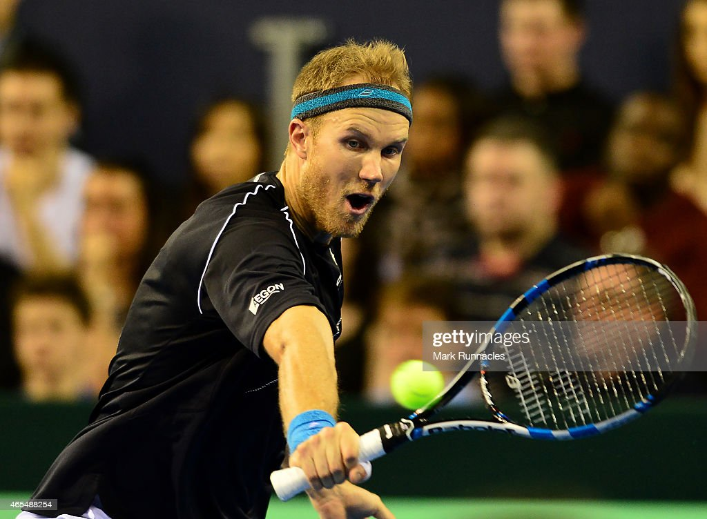 Dominic Inglot of the Aegon GB Davis Cup Team in action against Mike Bryan and Bob Bryan of the United States during the doubles match on Day 2 of...
