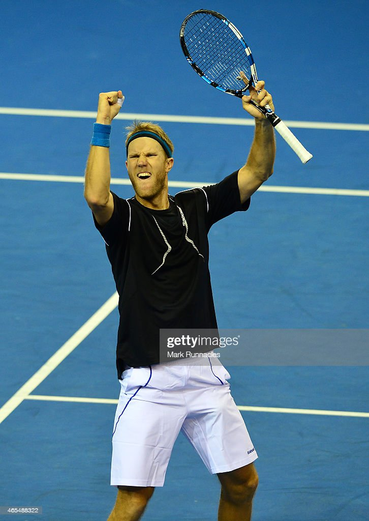 Dominic Inglot of the Aegon GB Davis Cup Team reacts after winning the fourth set against Mike Bryan and Bob Bryan of the United States during the...
