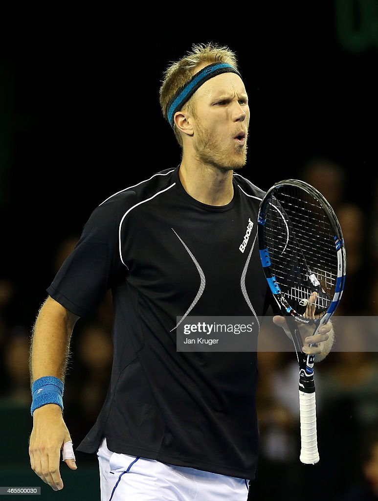 Dominic Inglot of The Aegon GB Davis Cup Team reacts in his doubles match against Mike and Bob Bryan of the United States during Day 2 of the Davis...