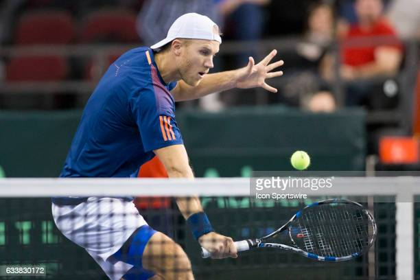 Dominic Inglot volleys the ball against Vasek Pospisil and Daniel Nestor of Canada in men's doubles play on February 04 during the Davis Cup first...