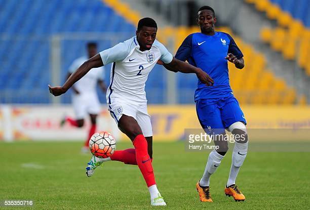 Dominic Iorfa of England is tackled by Brahim Konate of France during the Final of the Toulon Tournament between England and France at Parc Des...