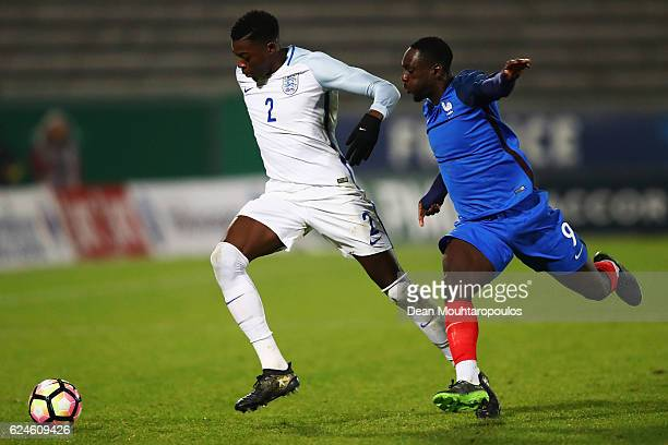 Dominic Iorfa of England U21 battles for the ball with JeanKevin Augustin of France U21 during the U21 International Friendly match France U21 and...