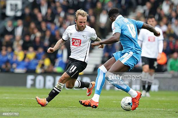 Dominic Iorfa of Wolverhampton Wanderers FC wins possession after a successful tackle of Johnny Russell of Derby County FC during the Sky Bet...