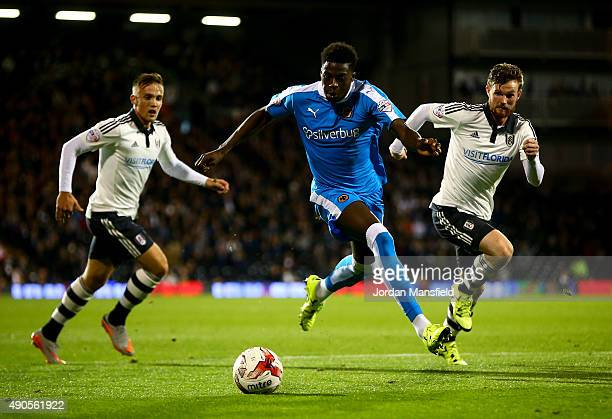 Dominic Iorfa of Wolves takes the ball past Lasse Vigen Christenses and Tim Ream of Fulham during the Sky Bet Football League Championship match...
