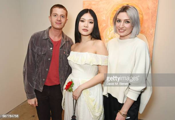 Dominic Jones Faye Wei Wei and Victoria Williams attend a private view of artist Faye Wei Wei's exhibition 'Anemones And Lovers' at Cob Gallery on...
