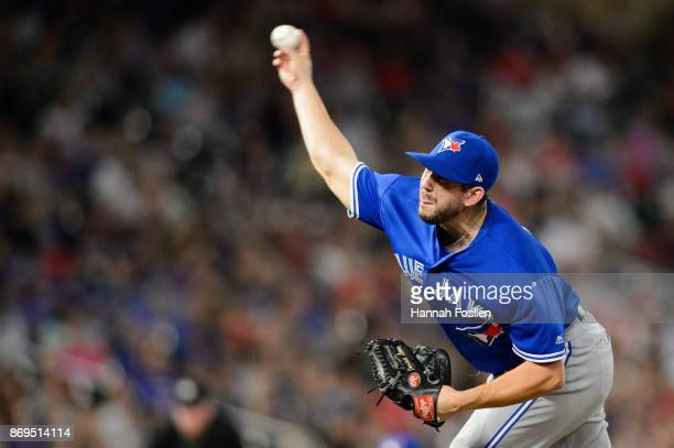 Dominic Leone of the Toronto Blue Jays delivers a pitch against the Minnesota Twins during the game on September 15 2017 at Target Field in...
