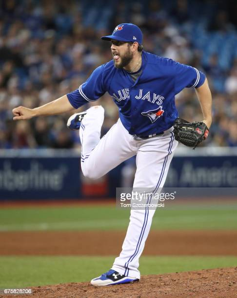 Dominic Leone of the Toronto Blue Jays delivers a pitch in the eighth inning during MLB game action against the Tampa Bay Rays at Rogers Centre on...