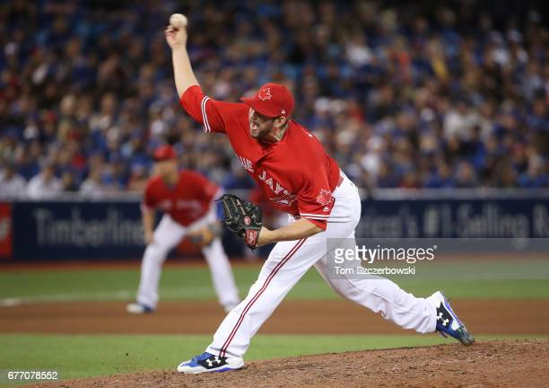 Dominic Leone of the Toronto Blue Jays delivers a pitch in the seventh inning during MLB game action against the Tampa Bay Rays at Rogers Centre on...