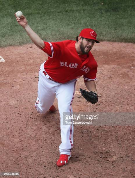 Dominic Leone of the Toronto Blue Jays delivers a pitch in the seventh inning during MLB game action against the Texas Rangers at Rogers Centre on...