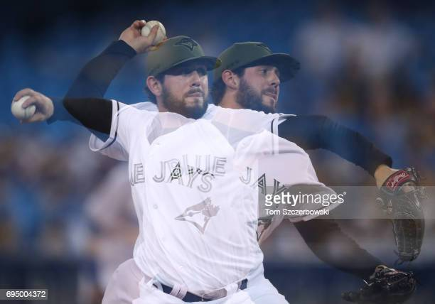 Dominic Leone of the Toronto Blue Jays delivers a pitch in the seventh inning during MLB game action against the Cincinnati Reds at Rogers Centre on...