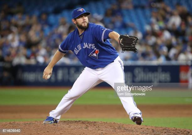 Dominic Leone of the Toronto Blue Jays delivers a pitch in the ninth inning during MLB game action against the Tampa Bay Rays at Rogers Centre on...