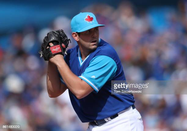 Dominic Leone of the Toronto Blue Jays looks in before delivering a pitch in the eighth inning during MLB game action against the Minnesota Twins at...
