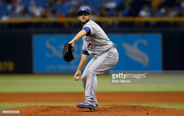 Dominic Leone of the Toronto Blue Jays pitches during the first inning of a game against the Tampa Bay Rays on April 7 2017 at Tropicana Field in St...